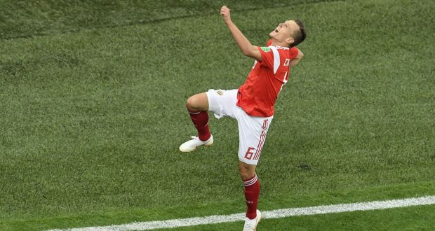 e78cd291b Russia s Denis Cheryshev celebrates scoring his team s second goal during  the World Cup Group A match