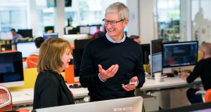 "Apple CEO Tim Cook visits Irish developer Hostelworld in Dublin. He said the company was committed to Ireland. ""We've been here since 1980. We have a very long-term relationship with the country""."