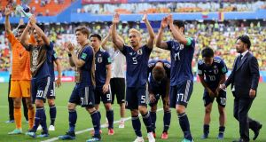 Japan players celebrate after their victory over Colombia at Mordovia Arena in Saransk yesterday. Photograph: Elsa Garrison/Getty Images