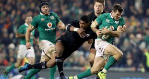 New Zealand's Waisake Naholo and Beauden Barrett tackle Jared Payne of Ireland during the Guinness Series clash in 2016. Photo: Dan Sheridan/Inpho