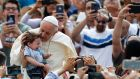 Pope Francis kisses a child as he arrives to attend his weekly general audience, in St. Peter's Square, at the Vatican last week. Photograph: Riccardo De Luca/AP