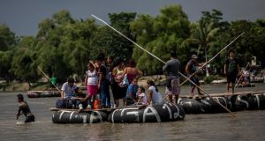 "Migrants using handmade rafts cross the river that separates Guatemala from Mexico near Hildago City, Mexico, on June 19th. As word of the Trump administration's new ""zero tolerance"" policy reaches the migrant trail, some reconsidered their trips. Photograph: Alejandro Cegarra/The New York Times"