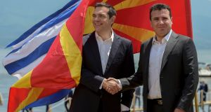 Greek prime minister Alexis Tsipras (L) and FYROM prime minister Zoran Zaev (R) shake hands after their arrival on Macedonian side of the Lake Prespa, near Otesevo, the Former Yugoslav Republic of Macedonia on Sunday. Photograph: Nake Batev/EPA