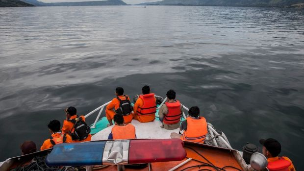 Rescue team members search for missing passengers on Lake Toba in the province of North Sumatra on Wednesday. Photograph: Ivan Daman/AFP/Getty Images