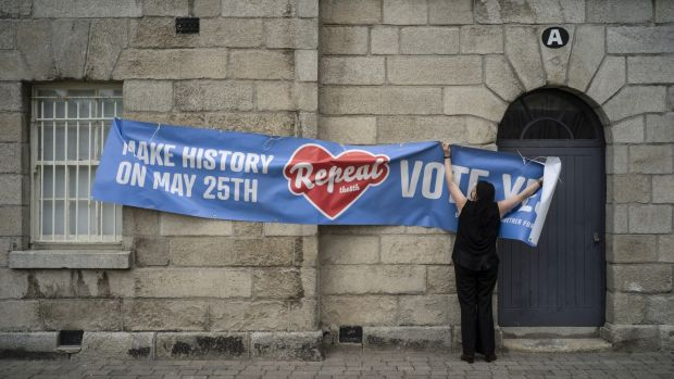 Brenda Malone shows a banner used during the abortion referendum. She says she has not received posters or banners for the No side. Photograph: Paulo Nunes dos Santos/The New York Times