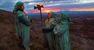 Druids journey across the McGillycuddy Reeks in Kerry by torchlight on their way to the ancient sacred summit, the Paps of Danú.  Photograph: Valerie O'Sullivan