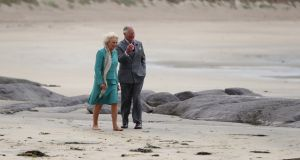 Prince Charles and Camilla, Duchess of Cornwall walk on Derrynane beach in Co Kerry during their visit to the  Republic. Photograph:  Niall Carson/Getty Images