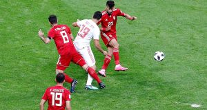 Diego Costa   scores Spain's goal after a clearance attempt by Iran's Ramin Rezaeianin bounced off his leg in  World Cup Group B  game   in Kazan. Photograph: Photograph: Sergey Dolzhenko/EPA