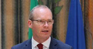 "Minister for Foreign Affairs Simon Coveney: ""It is deeply regrettable to see the good name of America being damaged by the shocking images that have been seen around the world in recent days."" Photograph: EPA"