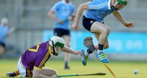 Dublin's Fergal Whitley in action against  Garry Molloy of Wexford during the Bord Gáis Energy Leinster Under-21 Hurling Championship Semi-Final at  Parnell Park. Photograph: Oisín Keniry/Inpho