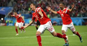 Artem Dzyuba of Russia celebrates scoring against Egypt at Saint Petersburg Stadium. Photograph: Getty Images