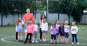 Ciaran Duffy and the girls at a training session at St Marys Youth Club in East Wall, Dublin. Photograph: Cyril Byrne