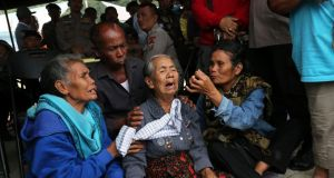 Relatives of missing passengers from a ferry accident on Lake Toba wait for news at a command post at Tigaras port in Simalungun, North Sumatra. Photograph: Antara Foto/Irsan Mulyadi/Reuters