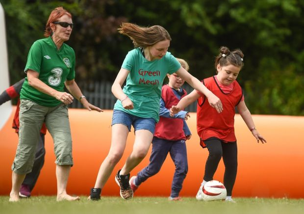Ella Murphy (13) in action against eight-year-old Sophie O'Reilly during the visually-impaired football training and match day at St Joseph's Primary School in Drumcondra, Dublin.