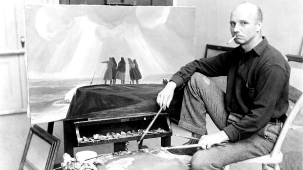 Rockwell Kent working on 'And Women Must Weep' or 'Shipwreck, Coast of Ireland', 1927- 1928.