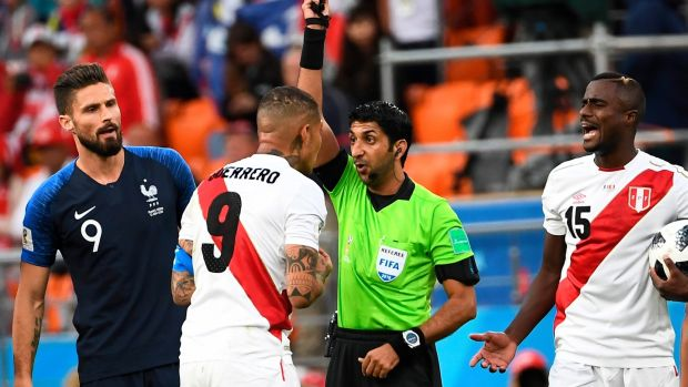 Referee Mohammed Abdulla Mohamed shows Peru's Paolo Guerrero a yellow card during his side's defeat to France. Photograph: Anne-Christine Poujoulat/AFP