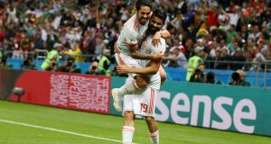 Spain's Diego Costa  celebrating with team mate Isco after scoring  against  Iran  at Kazan Arena. Photograph:    Francois Nel/Getty Images