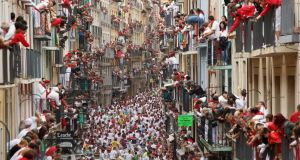The  calle Estafeta during the San Fermin bull-running festival in Pamplona: event brings about a million visitors to the city from across Spain and abroad. Photograph:  Pablo Blazquez Dominguez/Getty
