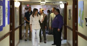 US first lady Melania Trump walks through the facility after a round table discussion with doctors and social workers at the Upbring New Hope Childrens Centre in Texas. Photograph: Chip Somodevilla/Getty Images