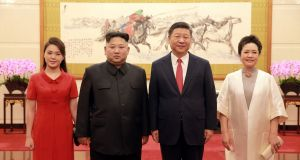 North Korean leader Kim Jong-un and his wife Ri Sol-ju (left) with Chinese president Xi Jinping and his wife Peng Liyuan in  Beijing.  Photograph: North Korea's Korean Central News Agency