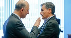 European commissioner for economic and financial affairs Pierre Moscovici and Greek finance minister Euclid Tsakalotos:  EU officials are convinced the Greek government under Alexis Tsipras remains committed to  stiff fiscal targets. Photograph: Julien Warnand