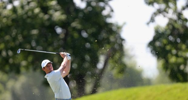 Rory McIlroy of Northern Ireland watches his second shot on the ninth hole  during the first e65d2020c