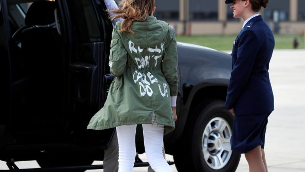 "US first lady Melania Trump walks from her plane to her motorcade wearing a Zara design jacket with the phrase ""I Really Don't Care. Do U?"" on the back as she returns to Washington from a visit to the US-Mexico border area in Texas. Photograph: Kevin Lamarque/Reuters"