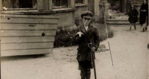 A  boy holds a sword in Cork City, 1920s. Photograph: National Photographic Archive (Hogan Wilson Images)