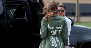 "US first lady Melania Trump walks from her to her motorcade wearing a Zara design jacket with the phrase ""I Really Don't Care. Do U?"". Photograph: Kevin Lamarque/Reuters"