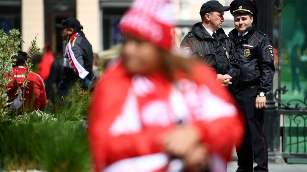 Police officers stand guard in the streets of Yekaterinburg before the match between France and Peru. Photograph: Getty Images