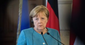 Merkel under pressure ahead of EU refugee mini-summit