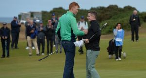 Robin Dawson (left), of Tramore is congratulated by opponent Conor Purcell of Portmarnock after his 3&2 win at the 16th hole during the semi final of The Amateur Championship at Royal Aberdeen. Photo: Mark Runnacles/R&A/R&A via Getty Images