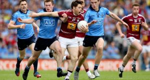 Dublin's Jack McCaffrey and Brian Fenton tackle Callum McCormack of Westmeath during the 2015 Leinster final. Photograph: James Crombie