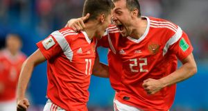 Russia's midfielder Roman Zobnin and Russia's forward Artem Dzyuba celebrate the opening goal against Saudi Arabia  at the Saint Petersburg Stadium. Photograph: Gabriel Bouys/AFP/Getty