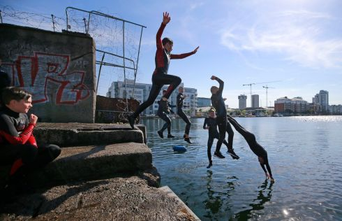 Dublin city swimmers in action as temperatures climb on the docks. Photograph: Nick Bradshaw