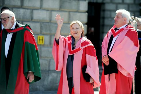 Hillary Clinton with Dr James Simons (left) and Paul Dreschler from the CBI in Trinity College Dublin where they received an honoury degree from the university today. Photograph: Aidan Crawley