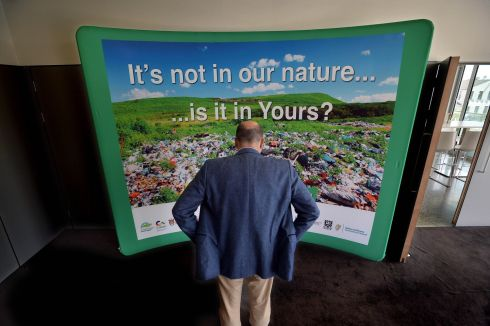Minister for Communications Denis Naughton inspects the billboard at the Roscommon County Council at the launch of the Connacht Ulster regional nti-dumping awarness campaign. Photograph: Ray Ryan