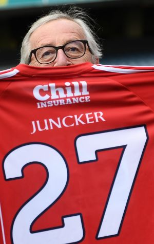 President of the European Commission Jean-Claude Juncker is presented with a Cork GAA jersey during a visit to Croke Park in Dublin. Photograph: Stephen McCarthy/Sportsfile