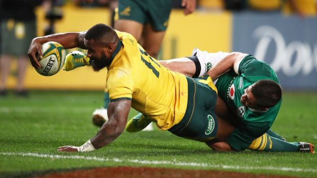 Johnny Sexton can't prevent Marika Koroibete from scoring in Sydney. Photograph: Matt King/Getty