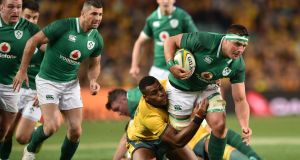 Ireland's CJ Stander makes one of his 15 carries in Sydney. Photograph: Getty Images