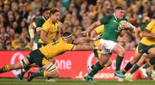 Ireland's  Tadhg Furlong evades the tackle of  Australia's Izack Rodda during the third Test in Sydney. Photograph:   Peter Parks/AFP/Getty Images