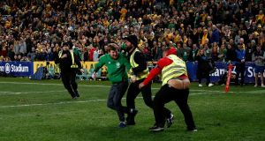 A security guard loses his trousers as he chases down a pitch invader after Ireland's win over Australia at the Allianz Stadium in Sydney. Photograph: Brook Mitchell/Getty Images