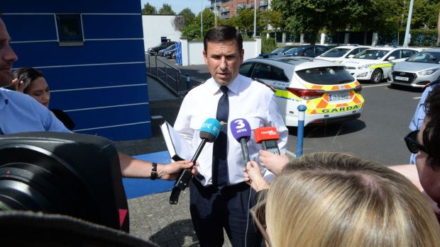 Supt Ian Lacken speaking to reporters about the death of a man in Tallaght today at Butler Park. Photograph: Cyril Byrne/The Irish Times