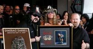 Pantera founder and drummer Vinnie Paul with Rita Hane and Jerry Abbott unveil a plaque in honour of former Pantera guitarist, the late Darrell 'Dimebag' Abbott during the induction to the Hollywood Rock Walk at Guitar Center, Hollywood, California, in 2007. File photograph:  Vince Bucci/Getty Images for VH1