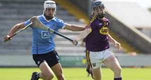 Alex O'Neill of Dublin in action against   Wexford's AJ Redmond  during the Electric Ireland Leinster  MHC semi-final at  Innovate Wexford Park. Photograph: Lorraine O'Sullivan/Inpho