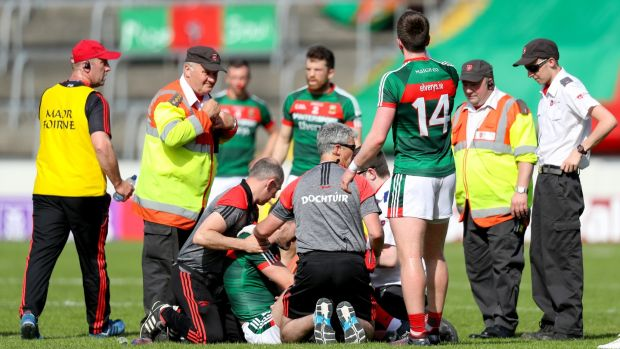 Mayo's Séamus O'Shea receives medical attention. Photograph: Oisin Keniry/Inpho