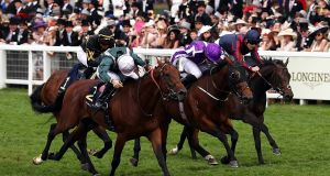 Ryan Moore (centre, purple colours) drives   Merchant Navy to the line to win  The Diamond Jubilee Stakes  at Royal Ascot. Photograph:  Bryn Lennon/Getty Images