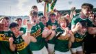The Kerry team celebrate with the trophy. Photograph: Ryan Byrne/Inpho