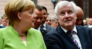 German chancellor Angela Merkel with interior minister Horst Seehofer. Photograph: Tobias Schwarz/AFP/Getty Images