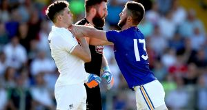 Kildare's David Hyland and goalkeeper Mark Donnellan clash with Robbie Smyth of Longford. Photograph: James Crombie/Inpho